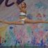 Dancer performs leap at StarQuest Dance Competition.