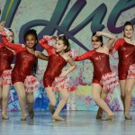 Female dancers hitting a pose during their routine at StarQuest Dance Competition