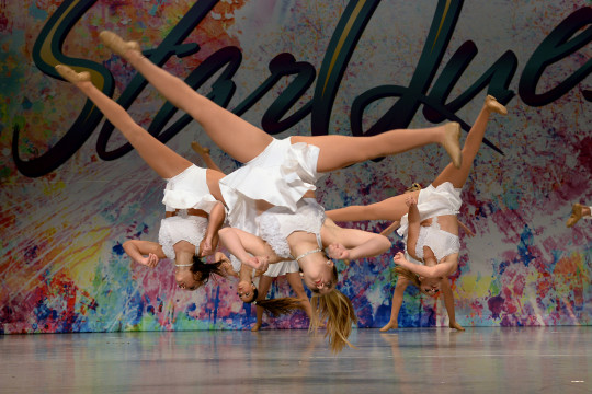 Dancers upside down on stage at StarQuest